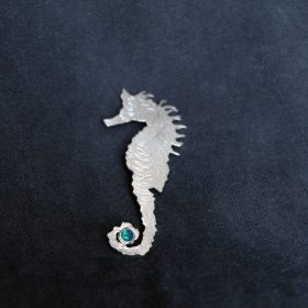 Silver seahorse and opal brooch