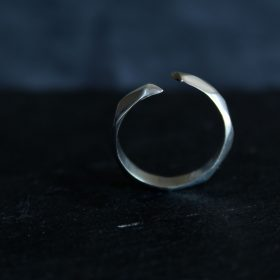 Silver faceted open ring